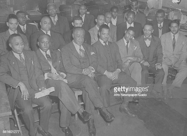 A group of men seated at a meeting in the Afro American newspaper offices Baltimore Maryland 1945