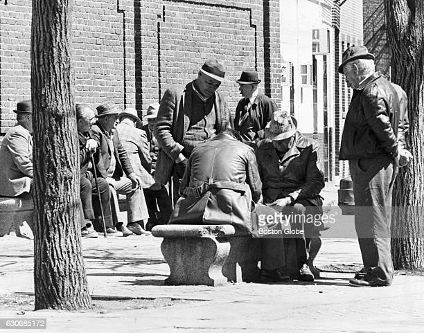 A group of men sit in Paul Revere Park in Boston's North End on May 1 1978