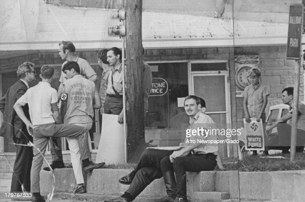 Group of men some with military uniforms and swastikas on street Cairo Illinois October 24 1970