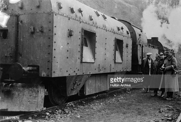 Group of men stand beside an armoured train used by the Austrian army, circa 1918.