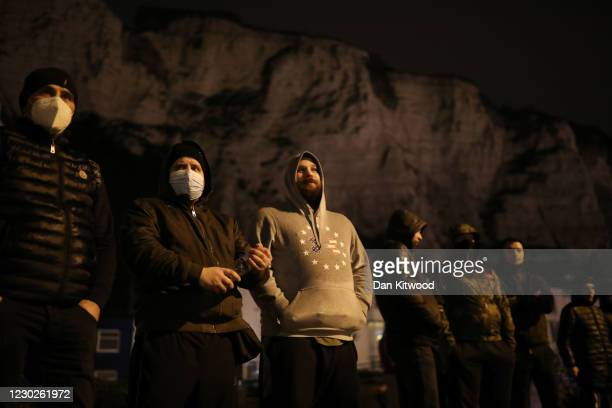 Group of men stand together in Dover as lorry drivers demand the reopening of the port on December 22, 2020 in Dover, United Kingdom. Over 1500...
