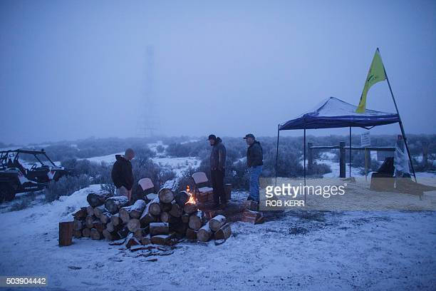 A group of men stay warm by a fire at the occupied Malheur National Wildlife Refuge on the sixth day of the occupation of the federal building in...