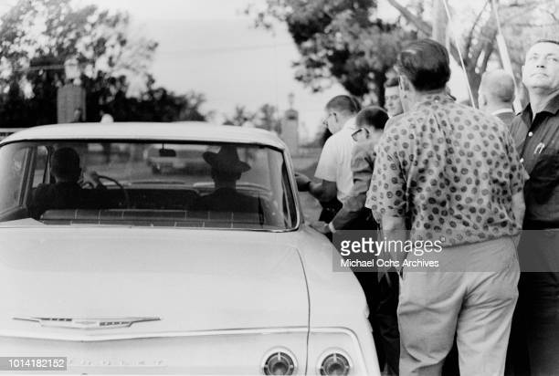 A group of men stop cars trying to enter the University of Mississippi campus in Oxford Mississippi during the Ole Miss Riot Of 1962 also known as...