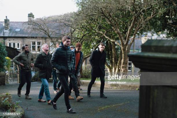 a group of men walking - prop stock pictures, royalty-free photos & images