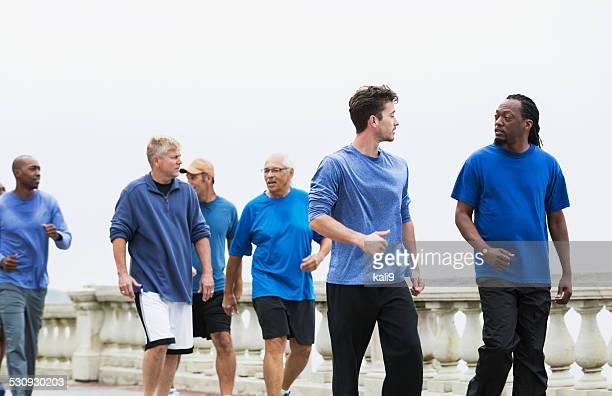 Group of men wearing blue shirts, power walking