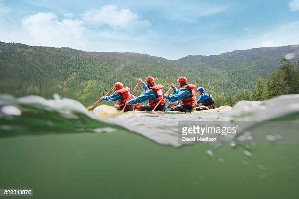 group of men whitewater rafting - rafting stock pictures, royalty-free photos & images