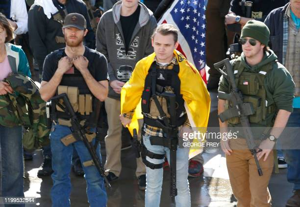 Group of men with their firearms listen to speakers at a protest to new gun legislation at the Utah State Capitol in Salt Lake City, Utah on February...