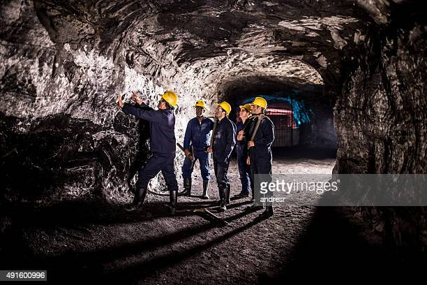group of men working at a mine - underground stock photos and pictures