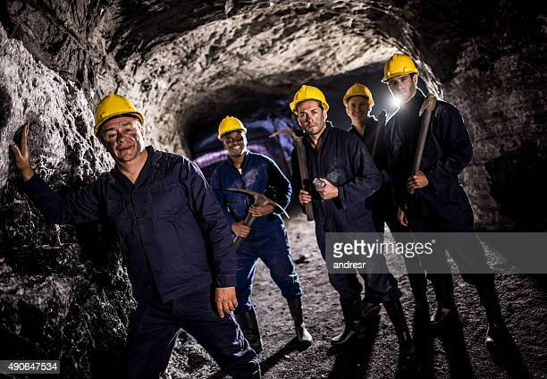 Group of men working at a mine underground