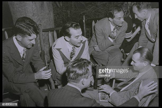A group of men working on the Manhattan Project get together for an informal gathering Stanislaw Ulam is talking to a man bent toward him Edwin...