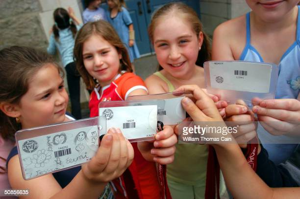 A group of Merion Elementary School students show their Air Clic cards as they arrive at the school May 19 2004 in Lower Merion Pennsylvania The...