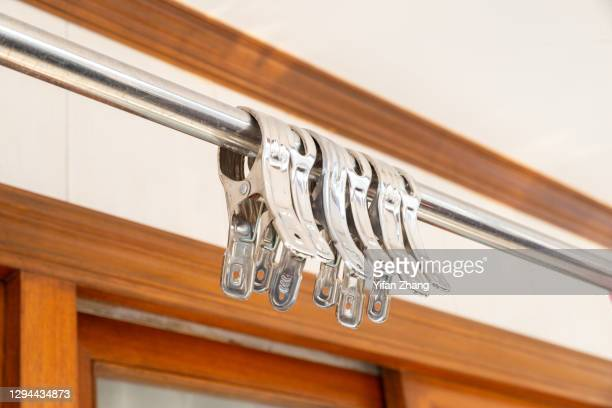a group of metal clothespins hang on the clotheshorse - changzhou stock pictures, royalty-free photos & images