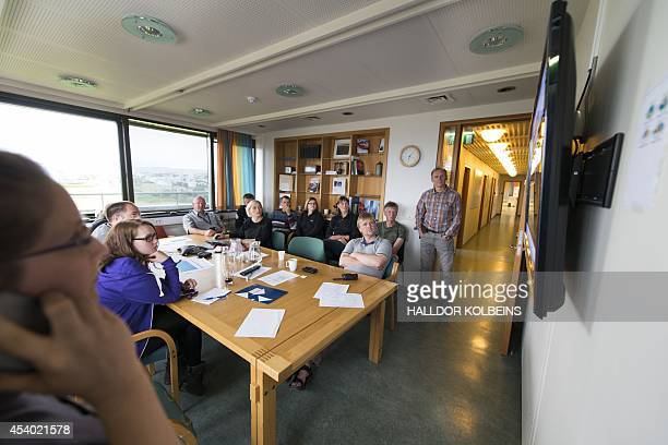 A group of meteorologists seismologists and scientists meet at the Icelandic met office in Reykjavik to monitor the Bardarbunga volcanic eruption on...