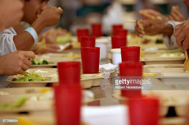 A group of Mexican and foreign nationals convicted of a felony or deportable offense sit in a cafeteria during lunch hour at the El Centro California...