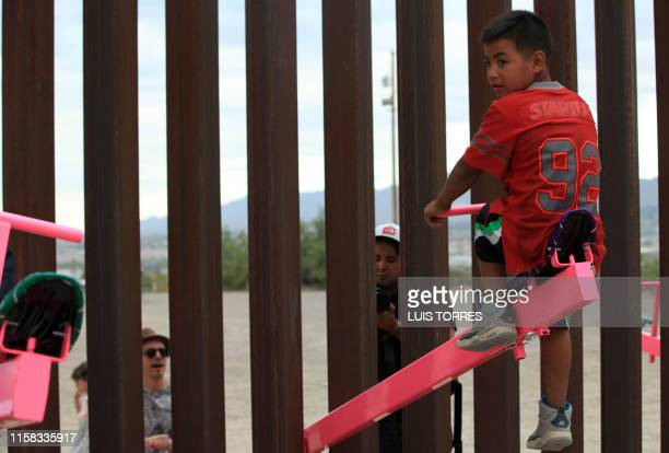 A group of mexican kids plays with a toy called up and down over the Mexican border with US at the Anapra zone in Ciudad Juarez Chihuahua State...