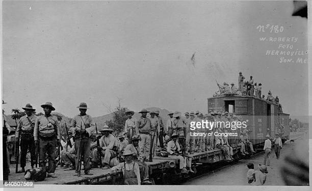 A group of Mexican soldiers ride a flatbed freight car to the next battle in the Mexican Revolution Hermosillo Sonora Mexico
