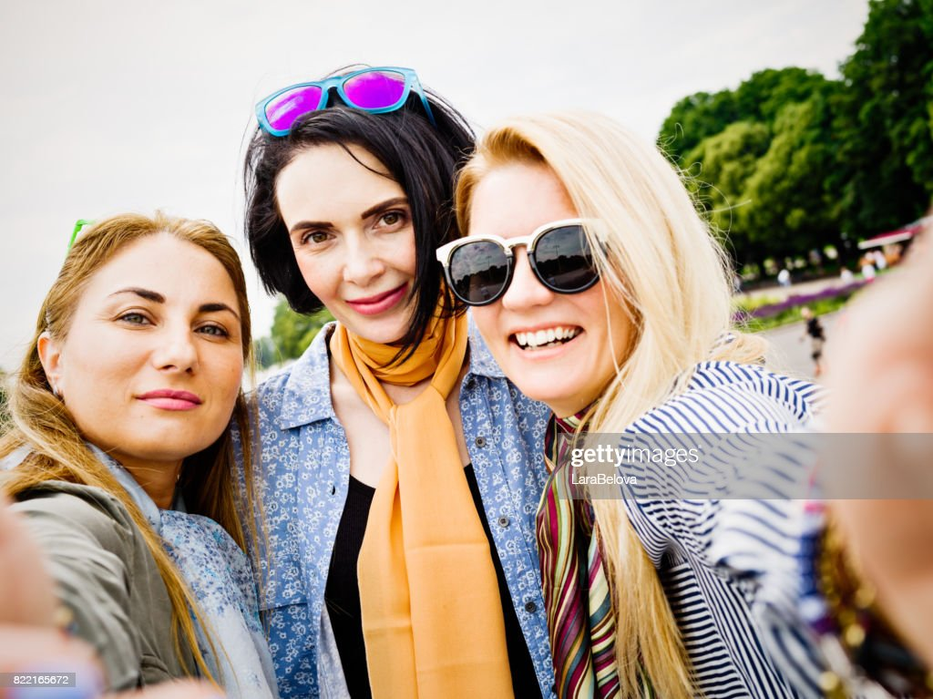 Group of mid age women in public park : Stock Photo