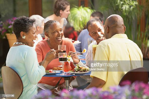Group of middle-aged friends at outdoor restaurant