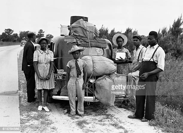 A group of migrant workers from Florida stop alongside the road in Sawboro North Carolina on their way to Cranberry New Jersey to pick potatoes July...