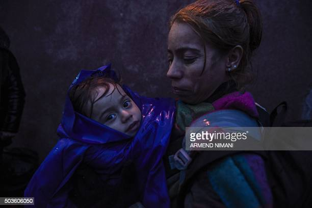 Group of migrants and refugees wait at a train station for a train in southern Serbian town of Presevo on January 6, 2016. The International...