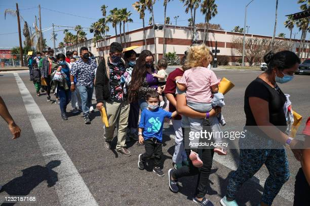 Group of migrants are seen as they were taken to shelters by US officials after the registration process and COVID-19 tests in McAllen, Texas, United...