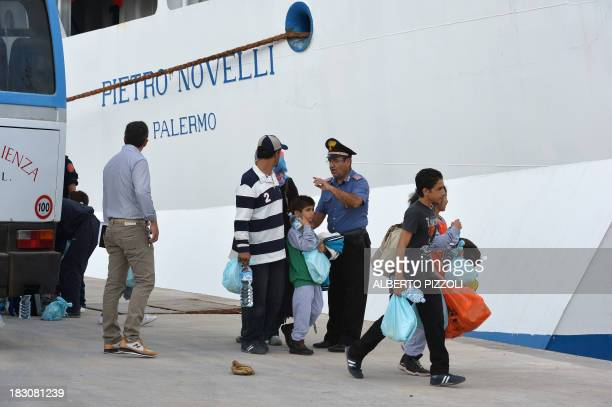A group of migrants arrived in Lampedusa few days ago is transferred to Sicily on October 4 2013 in Lampedusa Italy mourned today the 300 African...