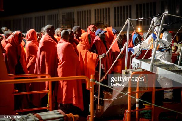 A group of migrants disembarking the Spanish vessel at the Malaga's port on October 6 Malaga