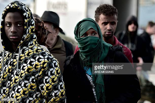 A group of migrants from Somalia that survived from an accident in the Aegean Sea last week arrive at the port of Piraeus in Athens on May 12 2014 At...