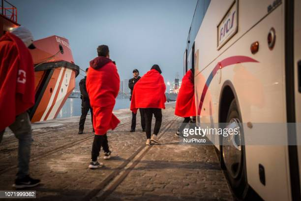 A group of migrants getting on the bus to go to the Care Unit On 7 December 2018 in Malaga Spain The Spanish Maritime vessel the quotSAR...