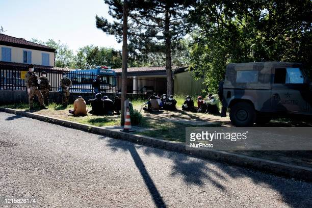 Group of migrants in the police station of the Italian border town Fernetti supervised by the army and the police after been discovered cross the...
