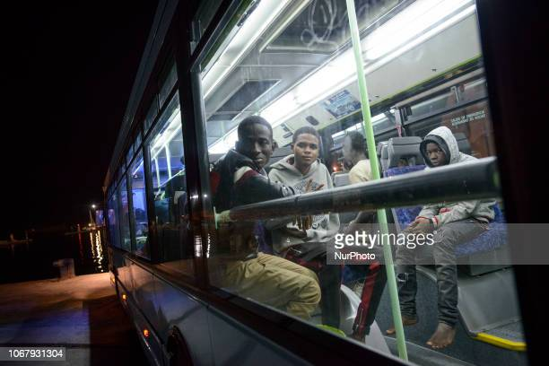 A group of migrants inside a bus to be transferred to the Red cross medical center on November 28 Malaga