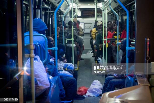 A group of migrants inside of a bus waiting to be transferred to a center Malaga The Spaniard Maritime vessel rescued in the Mediterranean sea 202...