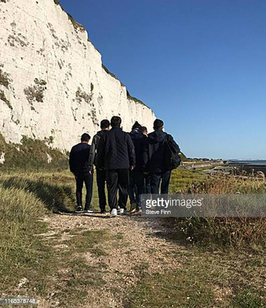 Group of migrants on the beach at Kingsdown on August 31, 2019 in Dover, England. 53 migrants have been intercepted crossing the English Channel from...