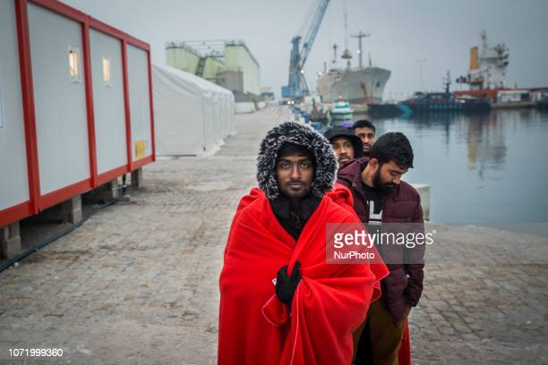 A group of migrants queuing at the Care unit On 7 December 2018 in Malaga Spain The Spanish Maritime vessel the quotSAR Masteleroquot rescued 130...