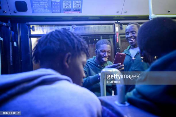 A group of migrants wearing new clothes inside of a bus to be transferred to a center Malaga