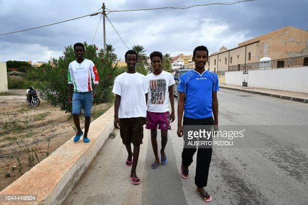 A group of migrants who recently arrived from Eritrea through Libya walk through Lampedusa on September 26 2018 Five years after the worst shipwreck...