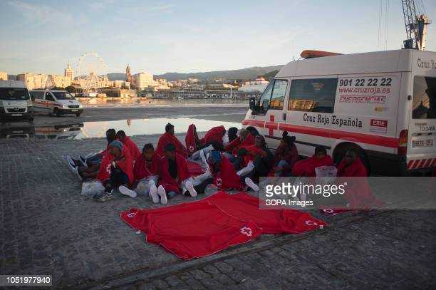 Group of migrants women are seen resting on the ground during their arrival at the Port. Spanish Maritime Rescue service has rescued 360 migrants...