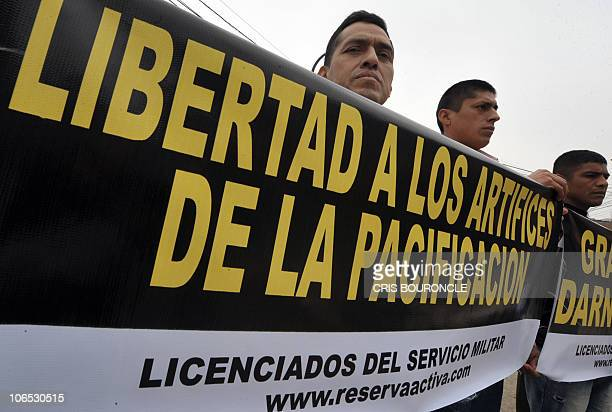 Group of military men stands with banners close to a court dependency in Lima on November 4, 2010 supporting 29 ex Army officers on the first day of...