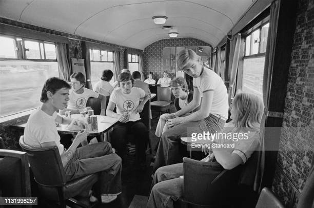 Group of Millwall FC supporters travelling on a train, UK, 26th August 1975.
