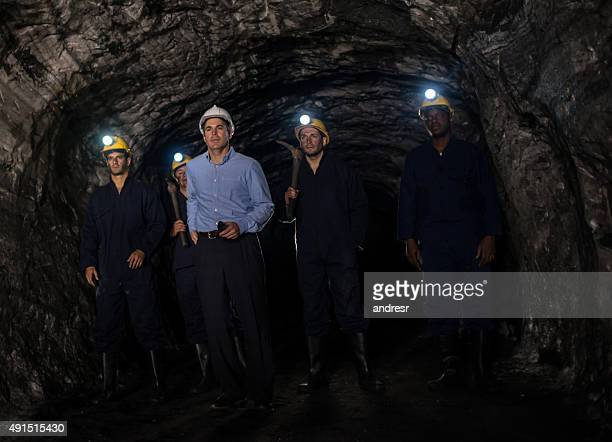 Group of miners at the mine with an engineer