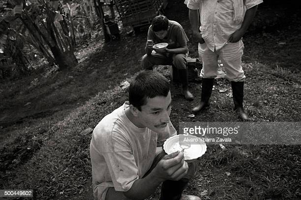 A group of miners eating at the end of their shift They work simply for food spending 12 hours underground each day with virtually no safety...
