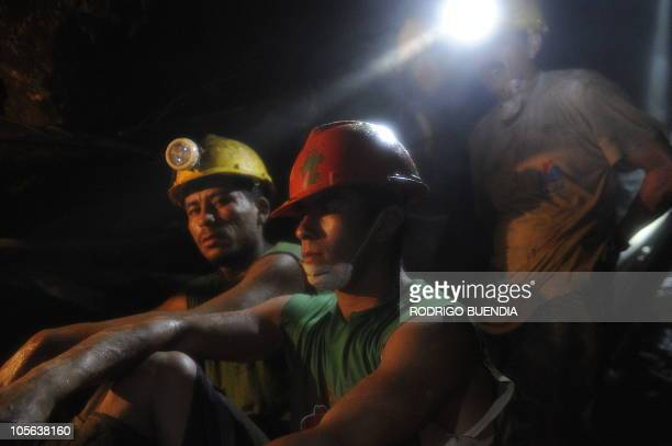 A group of miners from a rescue team take a rest in a 150metredeep shaft od Casa Negra mine in Portovelo Ecuador October 17 2010 Rescue crews dug...