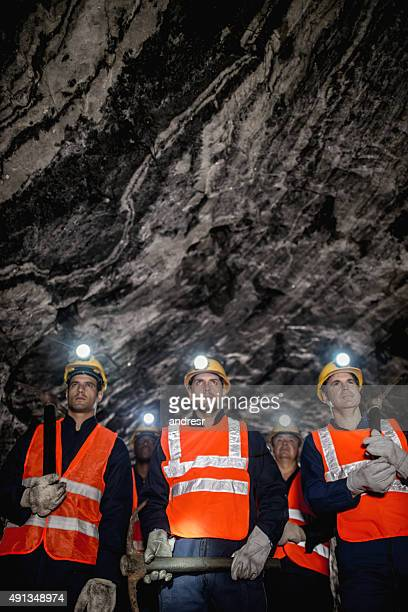 group of miners working at the mine - coal miner stock photos and pictures