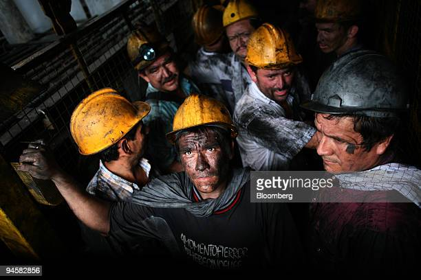 A group of miners working in the Coexminas emerald mine come out from within the mine on an elevator in Puerto Arturo near Muzo Colombia on Thursday...