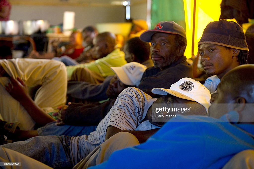 A group of mineworkers waiting for food at a church on January 17, 2013 in Carltonville, South Africa. About 80 miners found themselves stranded and had to find refuge at a church after they were locked out the Kusasalethu's mine hostels. The Kusasalethu shaft has been temporarily shut down due to violence and illegal sit-ins at the mine.