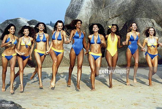 A group of Miss World contestants romp the beach of Sanya in southern China's resort island of Hainan 29 November 2003 in their swimsuits China will...