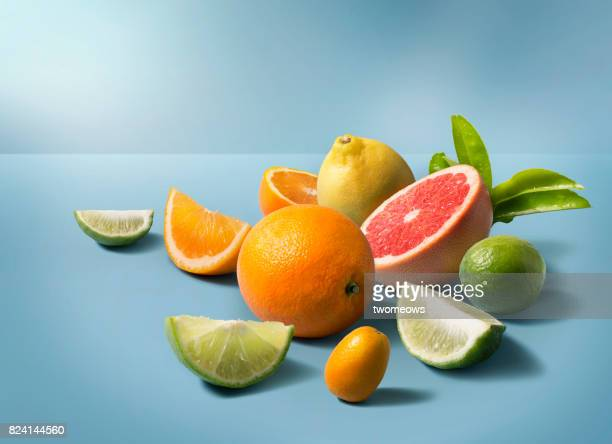 A group of mix citrus fruits on clean blue background.