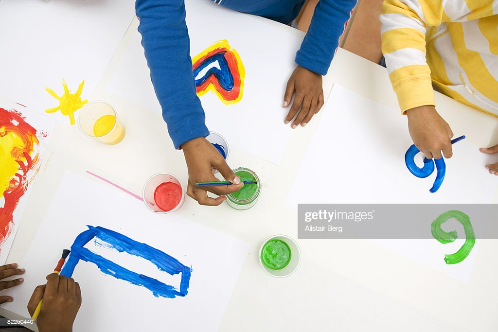 Group of mixed race children painting pictures : Stock Photo