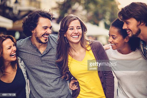 Group of mixed race young people smiling outdoors