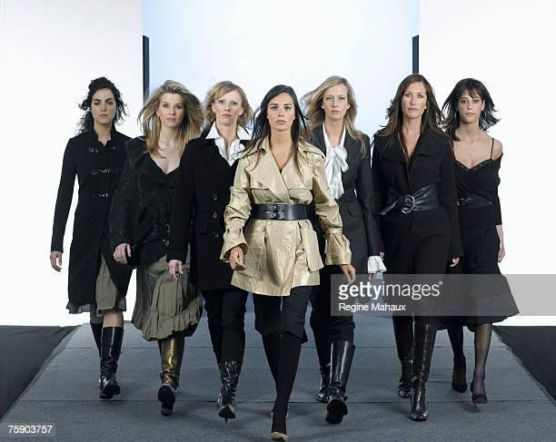 Group of models walking on fashion runway